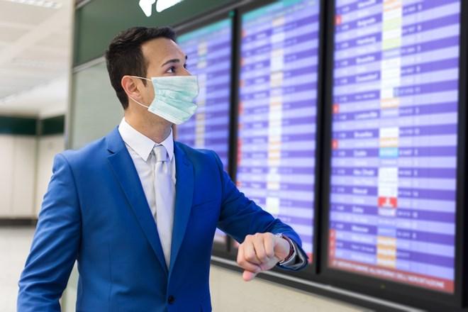 Mask business traveler shutterstock_1735211177