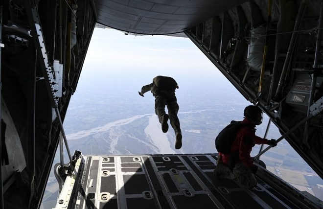 A service member jumps from a US Air Force C-130J Hercules during a Military Freefall Jumpmaster Course c USAF