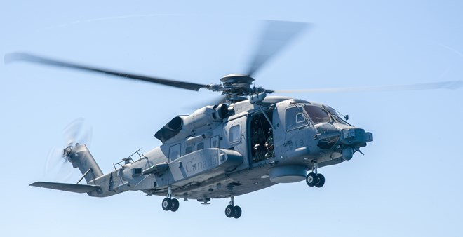 CH-138 in hover c RCAF