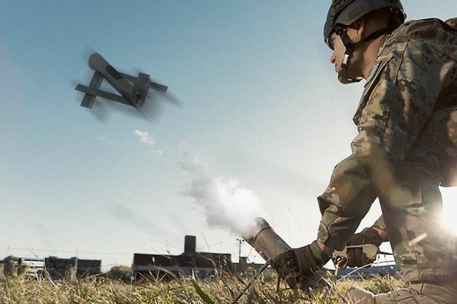 Soldier launching Switchblade c Aerovironment
