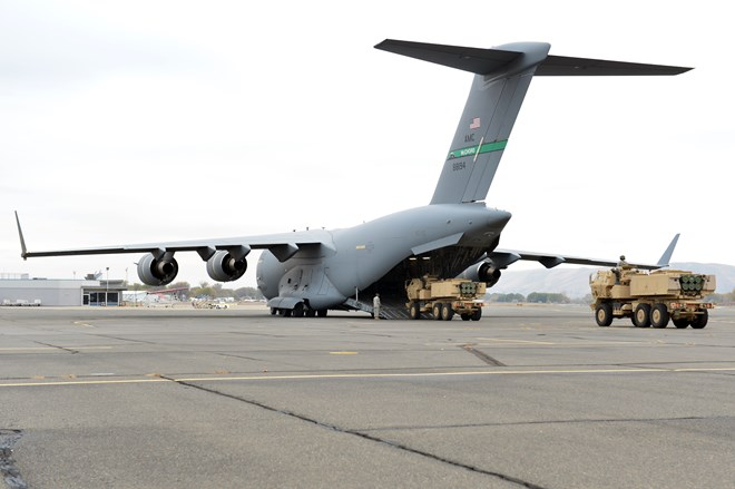 Two High Mobility Artillery Rocket System vehicles are loaded onto a C-17 Globemaster III c USAF