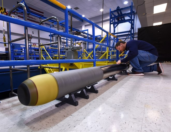 Northrop Grumman's Very Lightweight Torpedo prototype being prepared next to its Acoustic Test Facility tank in Annapolis Maryland.