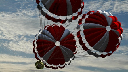 Orion capsule returns to Earth with its three para