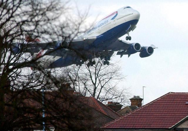 BA 747-400 above Heathrow housing