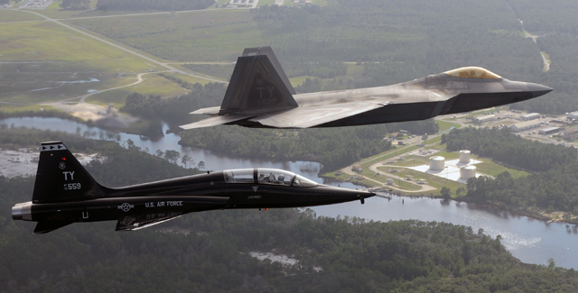 F-22 and T-38 over Tyndall AFB