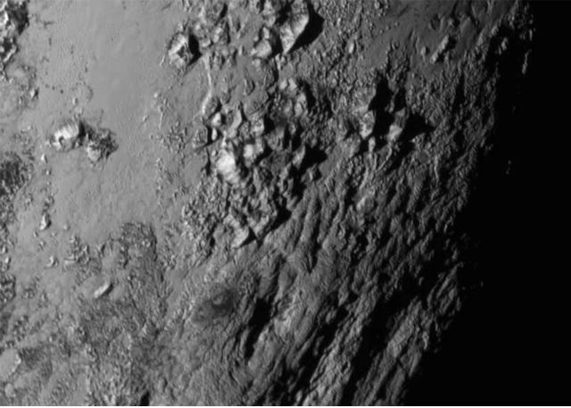 pluto mountains nasa rex