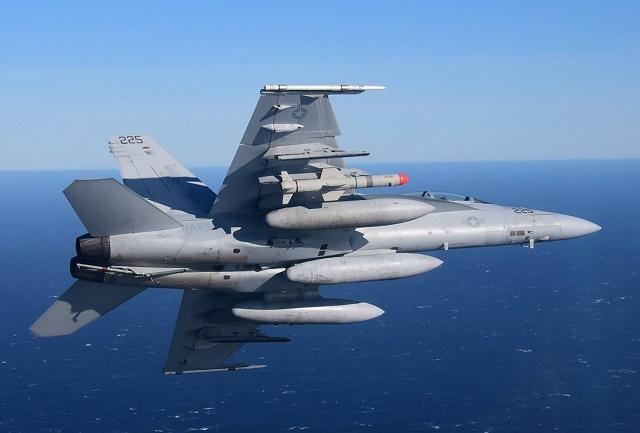 An F/A-18 carries the new Harpoon Block II+