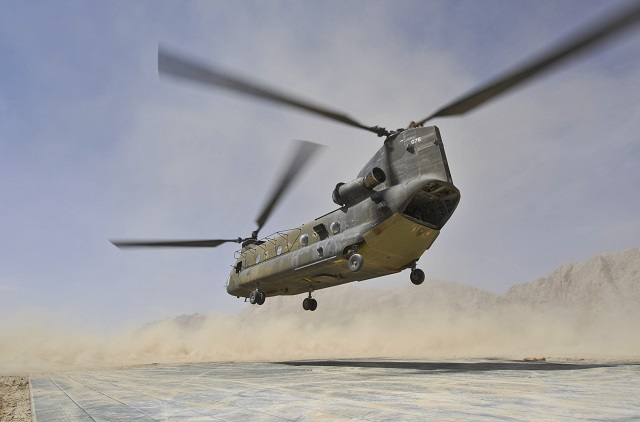 A CH-47 Chinook helicopter lands in brownout condi