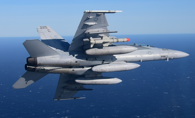 An F/A-18 carries the new Harpoon Block II+ missil
