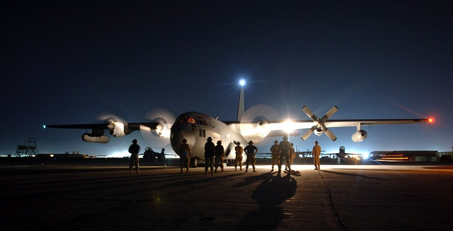 Maintainers at Bagram Air Base, Afghanistan, stand