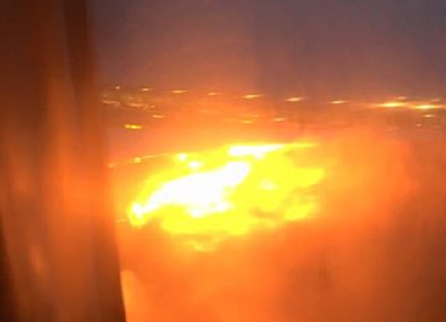 SIA 777 wing on fire.1