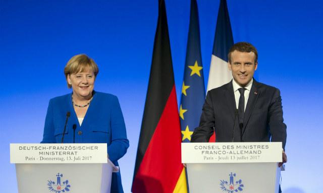 Merkel Macron - action press rex shutterstock