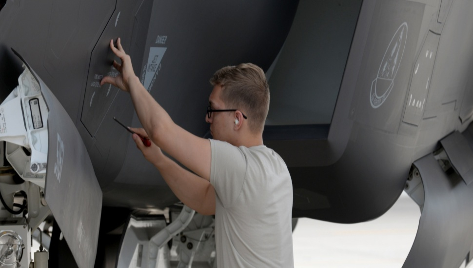 Crew member seals an F-35A Lightning II panel at L