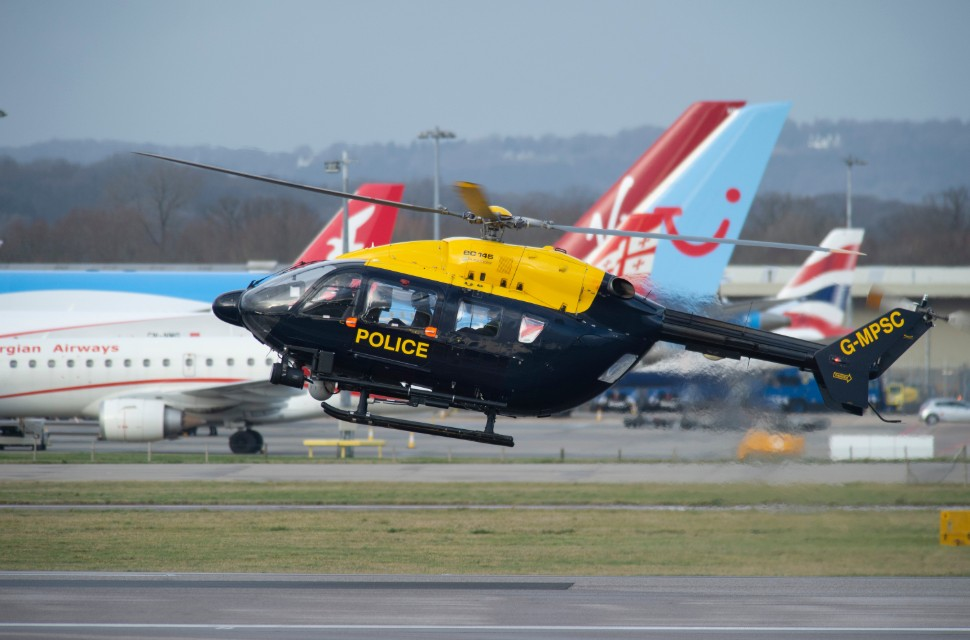 police helicopter looking for drone at Gatwick c G