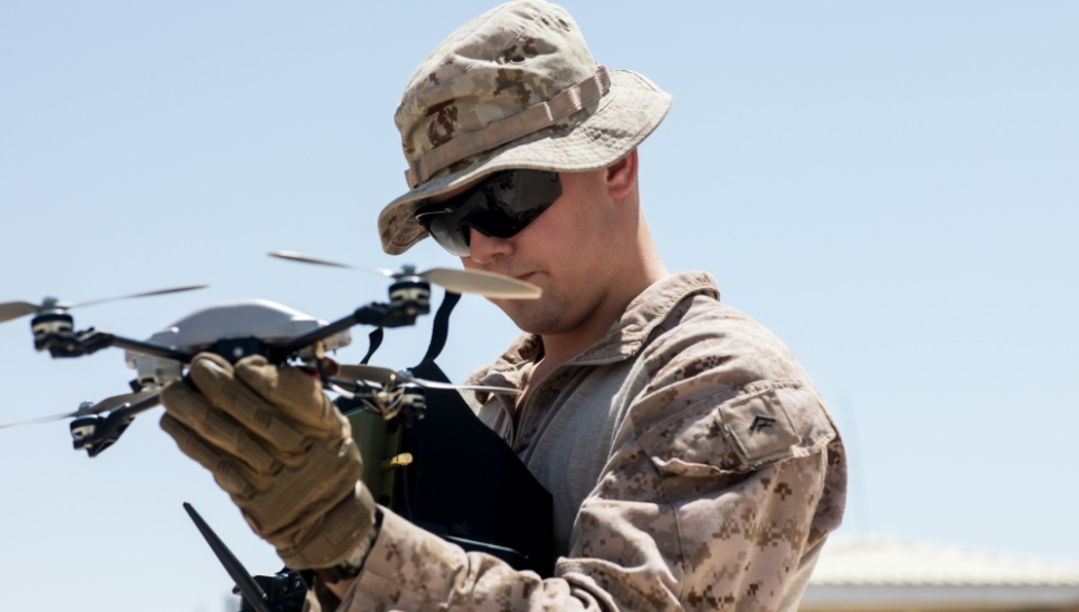 US marine prepares to launch InstantEye quadcopter