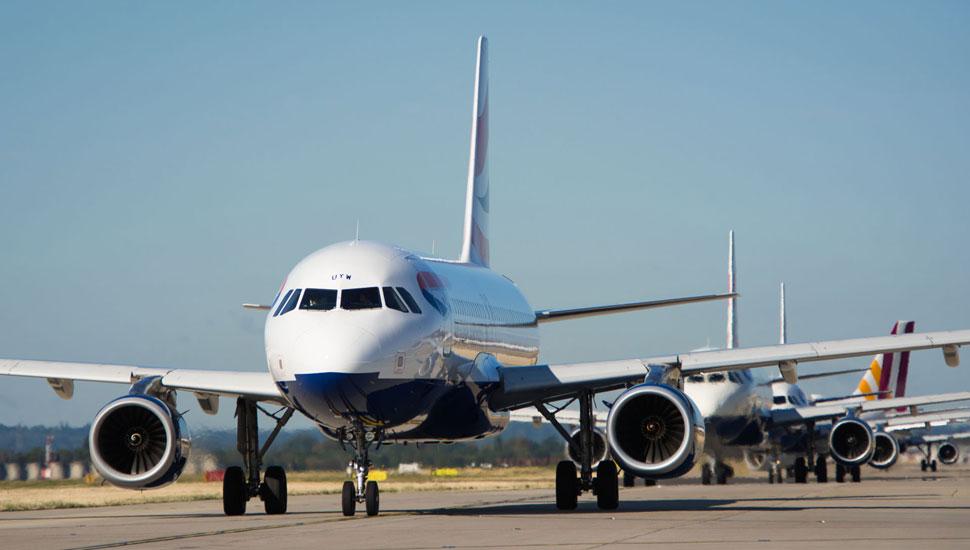 planes queued on runway at heathrow